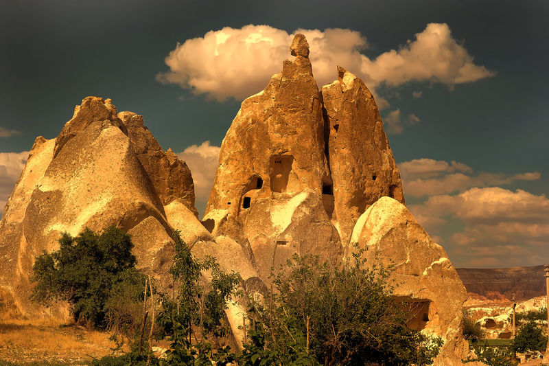 Panoramic view of rock formation against cloudy sky