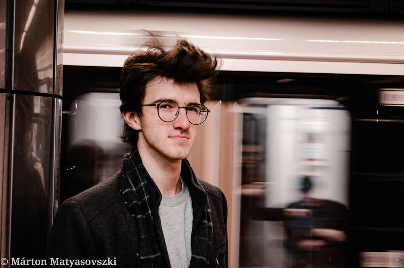 Portrait of young man in train