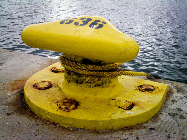 636 Dock Focus On Foreground Moorage No People Outdoors Port Ripples Strings Water Shine Water_collection Yellow Finding New Frontiers Paint The Town Yellow