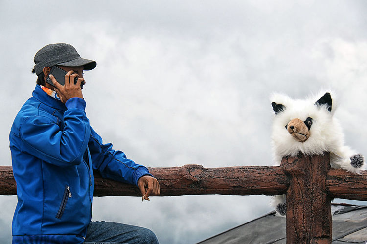 Talking to a Doll😂😂... Mobile Conversations Better Look Twice Outdoors Candid Photography Candid Calling Street Photography Interaction, at Tangkuban Perahu, Bandung, INDONESIA