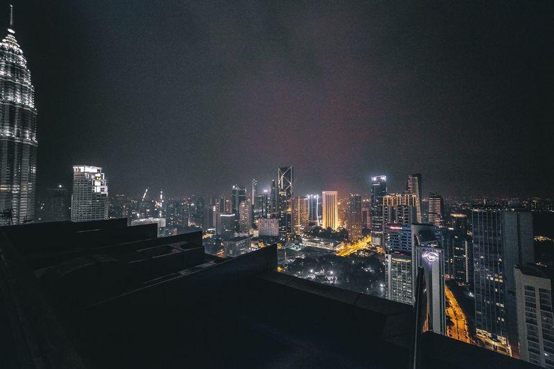 High angle view illuminated cityscape at night