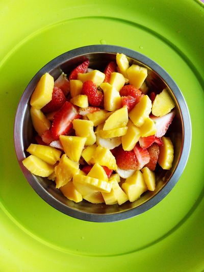 High angle view of chopped fruits in bowl