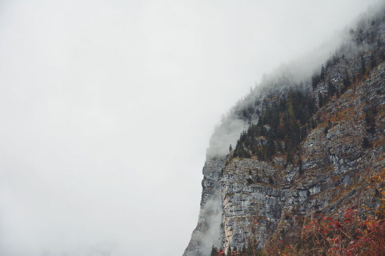 Low Angle View Of Mountain Against Sky During Winter