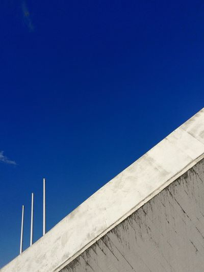 Architectural detail of building against blue sky