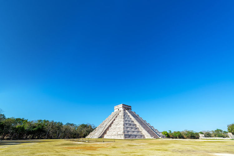 Wide angle view of the pyramid in the Mayan ruins of Chichen Itza in Mexico America Ancient Archaeology Architecture Chichen Chichen Itza Destination Famous Place History Landmark Mayan Mexican Mexico Ruins Sacrifice Site Stone Structure Temple Tourism Unesco Wonder Wonderworld World Yúcatan