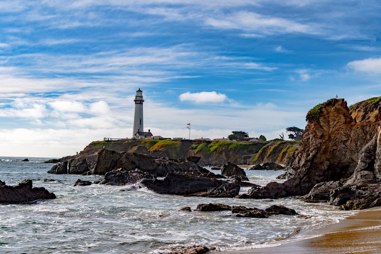 Beach Built Structure Cloud - Sky Day Direction Lighthouse Outdoors Rocky Coastline Scenics Sea Sky Tranquility Travel Destinations Water Wave