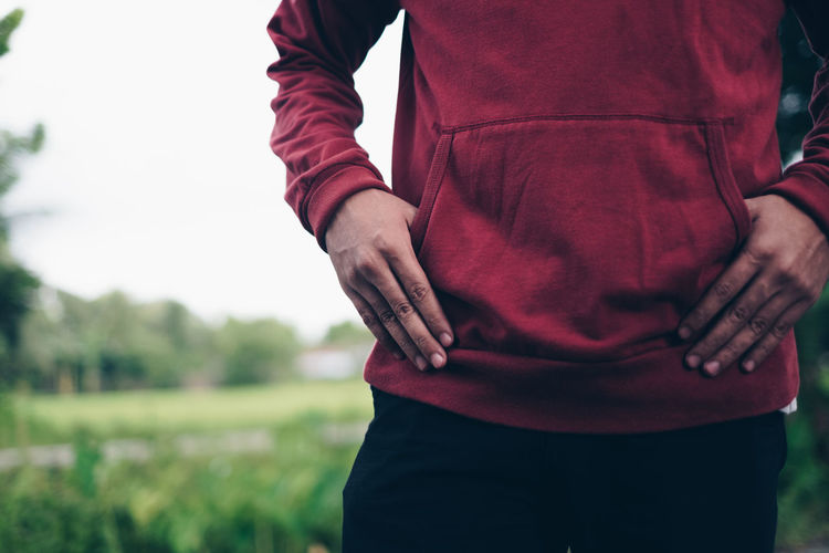 Midsection One Person Focus On Foreground Hand Standing Day Real People Casual Clothing Human Body Part Nature Lifestyles Field Close-up Human Hand Land Adult Clothing Backgrounds Copy Space Maroon Red Hoody Fingers Boy Fashion This Is Natural Beauty The Modern Professional A New Perspective On Life Holiday Moments Moments Of Happiness It's About The Journey Redefining Menswear Streetwise Photography The Art Of Street Photography Exploring Fun