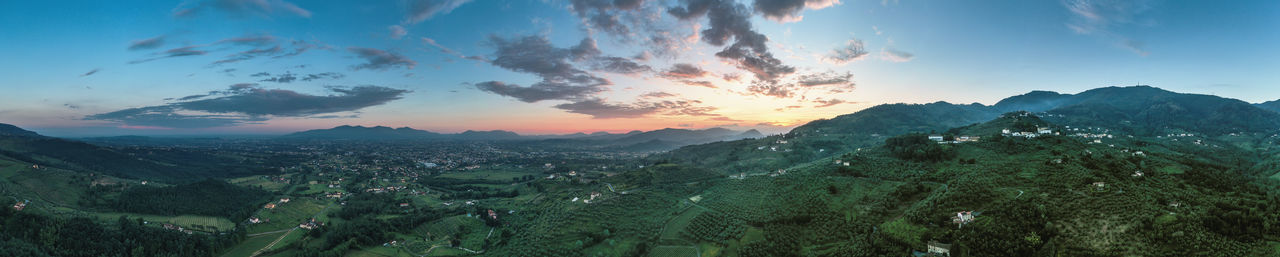Scenic view of winyards of tuscany against sky during sunset