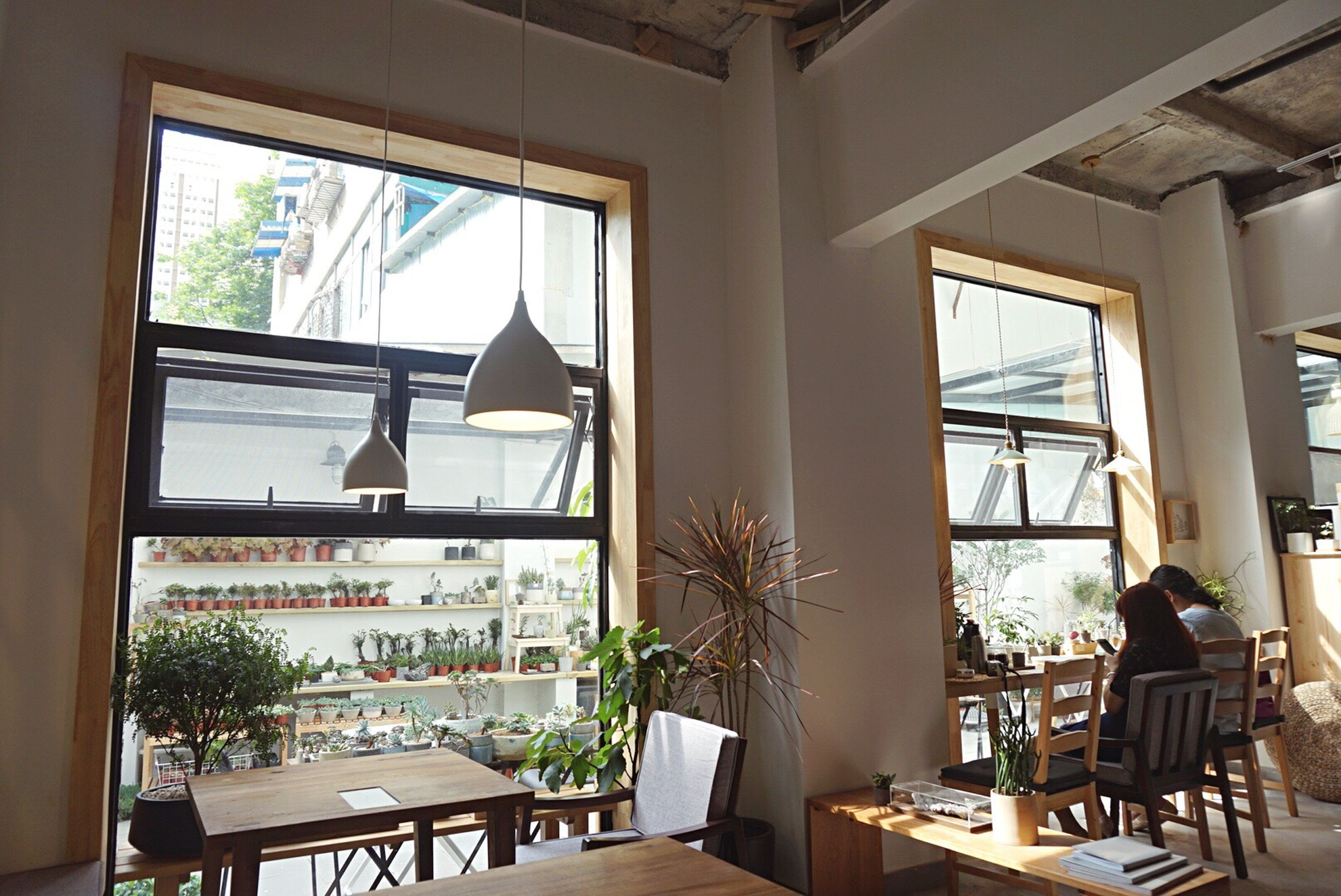 indoors, window, chair, glass - material, table, transparent, home interior, curtain, architecture, built structure, absence, potted plant, restaurant, house, balcony, day, empty, sunlight, glass, domestic room