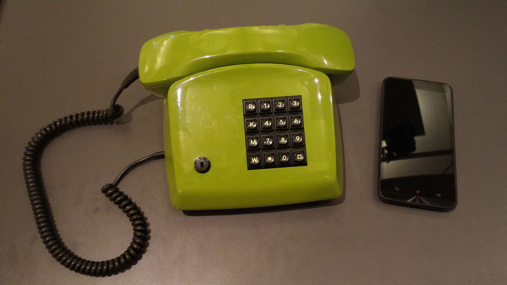 Old landline pnone vs. new smartphone Antique Call Cellphone Close-up Communication Comparison Connection Digital Evolution  History Landline Phone Mobile Nostalgia Number Old Vs New Old-fashioned Past Phone Cord Retro Styled Revolution Smartphone Table Technology Telephone Vs