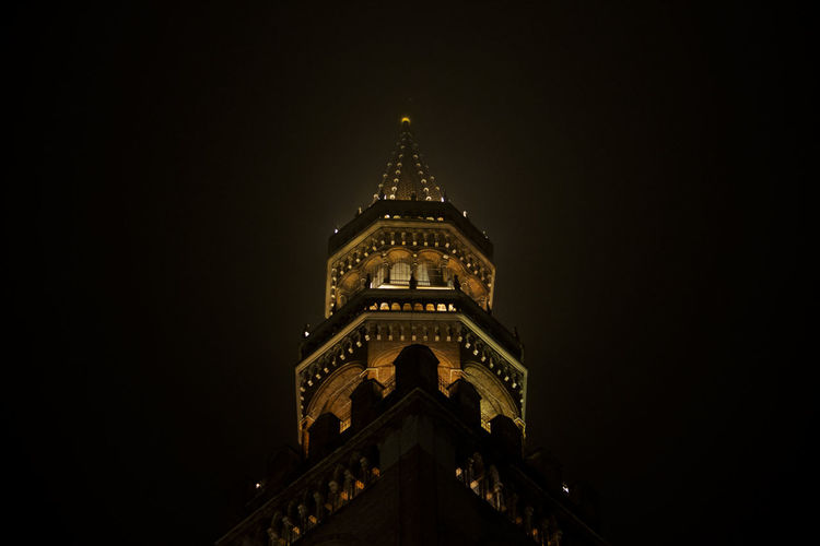 Low angle view of illuminated church against sky at night