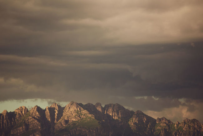 dull skies at sunset Beauty In Nature Cloud - Sky Day Environment Formation Landscape Mountain Mountain Peak Mountain Range Nature No People Non-urban Scene Outdoors Overcast Plant Scenics - Nature Sky Storm Tranquil Scene Tranquility Tree