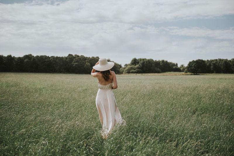 Woman walking on green field