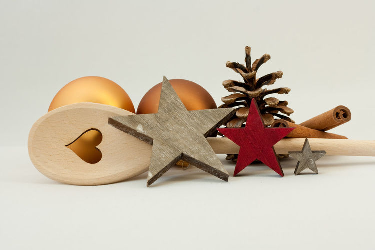 Still Life Studio Shot Indoors  White Background Food No People Close-up Decoration Creativity Copy Space Kitchen Restaurant Catering Merry Christmas! Christmas Christmas Ornament Wooden Spoon Happy Holidays! Celebration Backgrounds Pine Cone Christmas Decoration Star Holiday Holidays