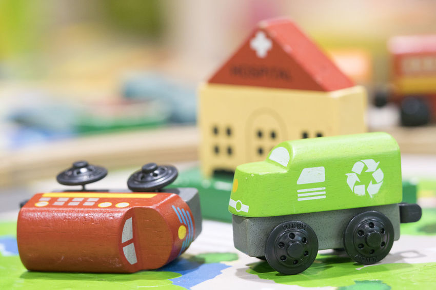 Wooden toy two trains on road with hospital in backdrop (selective focused),Toys for kids indoor playground Wooden Toys Wooden Toy Block Wooden Toy Train Toy Toy Car Childhood Focus On Foreground Car Toy Block Group Of Objects Close-up Multi Colored Green Color Wood - Material Architecture Still Life Block Shape
