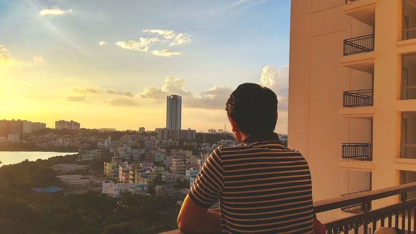 My friend Skyscraper Rear View Cityscape One Person Urban Skyline Evening Sun Light And Shadow EyeEm Selects High Angle View EyeEm Best Shots Firsreyeemphoto Top Perspective First Eyeem Photo EyeEm Gallery Redmi Note 4G Shot.. EyeEm Market © Real People Lifestyle Photography Sunset Lifestyles Architecture Portrait Of A Friend City Architecture Sky