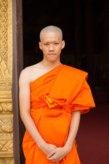 Monk Adult Adults Only Bald Buddhism Buddism Buddist Buddist Temple Day Golden Man Monk  One Person Orange Color Outdoors Peace People Portrait Religion Standing Standing Thai Worship Young Adult The Portraitist - 2018 EyeEm Awards