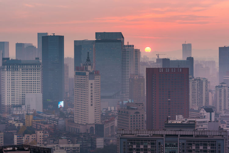 sunset in chengdu in centre Building Exterior Sunset Sky Built Structure City Architecture Building Office Building Exterior Skyscraper Cityscape Tall - High No People Modern Sun Nature Residential District Orange Color Tower Outdoors Urban Skyline Financial District  High Centre Chengdu
