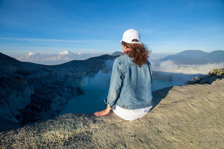 INDONESIA Adult Beauty In Nature Casual Clothing Day Kawah Ijen Leisure Activity Lifestyles Mountain Mountain Range Nature Non-urban Scene One Person Outdoors Real People Scenics - Nature Sky Sunlight Tourism Tranquil Scene Tranquility Travel Destinations Women Young Adult Young Women
