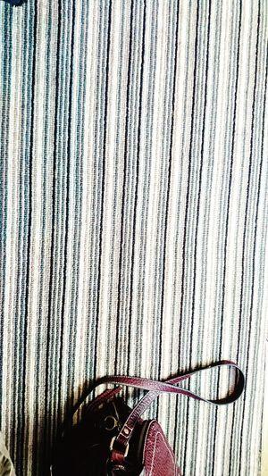 Exploring Style Close-up Stripes Pattern Carpet Handbag