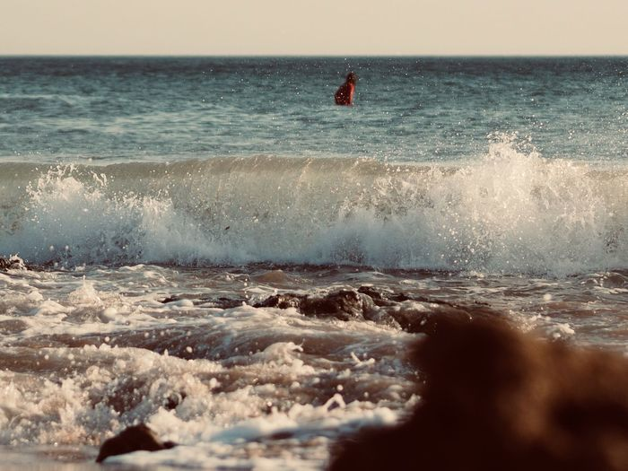 Sea Water Horizon Horizon Over Water Sport Motion Wave Aquatic Sport Sky Beauty In Nature Surfing Scenics - Nature Nature People Unrecognizable Person Leisure Activity Beach Day Outdoors Power In Nature