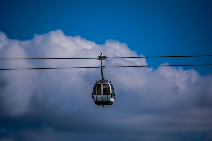 Cloud - Sky Sky Cable Cable Car Low Angle View Nature Hanging Blue No People Day Overhead Cable Car Transportation Mode Of Transportation Outdoors Connection Scenics - Nature Electricity  Power Line  Ski Lift Beauty In Nature