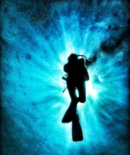 Low angle view of person scuba diving underwater