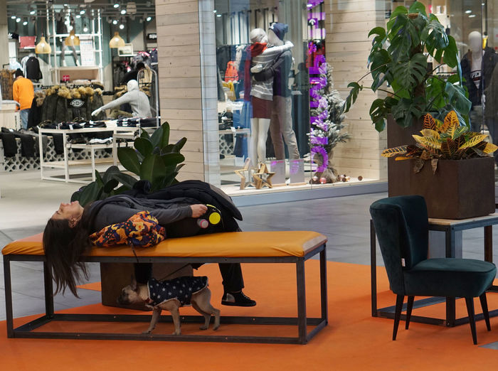 so much fun in a mall Seat Chair Flower Plant Flowering Plant Table Indoors  Vase Nature Furniture Architecture Decoration People Day Home Interior Real People Representation Flooring Art And Craft Business Fun Dog Mall Lying Down Bench