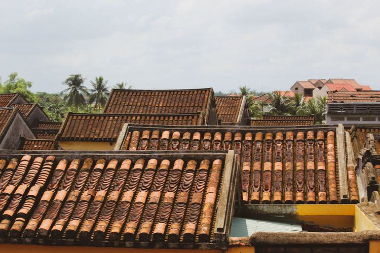 High angle view of roof and building against sky