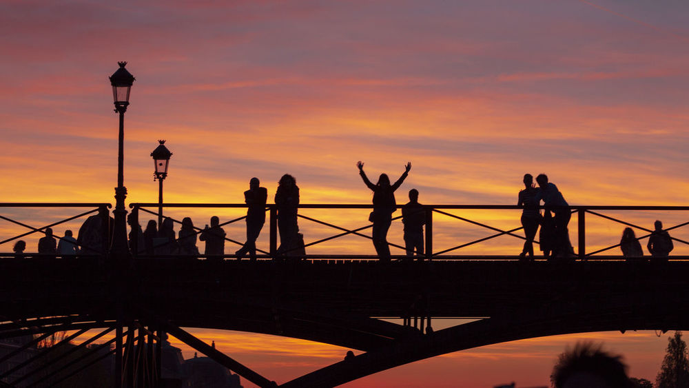 Joy This is how a evening become memorable. People enjoying sunset on a bridge over river Seine. Europe Trip France Paris Sky And Clouds Sunset_collection Travel Travel Photography Bridge Clouds And Sky Europe Evening Golden Hour Nature Nature_collection People Red Sky Silhouette Silhouette_collection Silhoutte Photography Sky Sky_collection Skyporn Sunset Travelgram Travelphotography #FREIHEITBERLIN The Street Photographer - 2018 EyeEm Awards