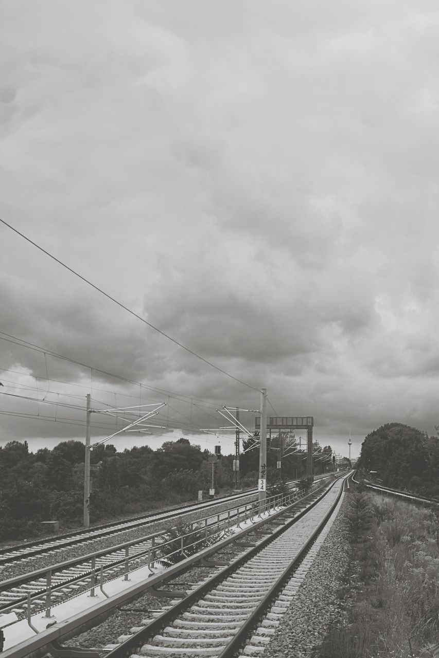 Railroad Tracks Against Cloudy Sky