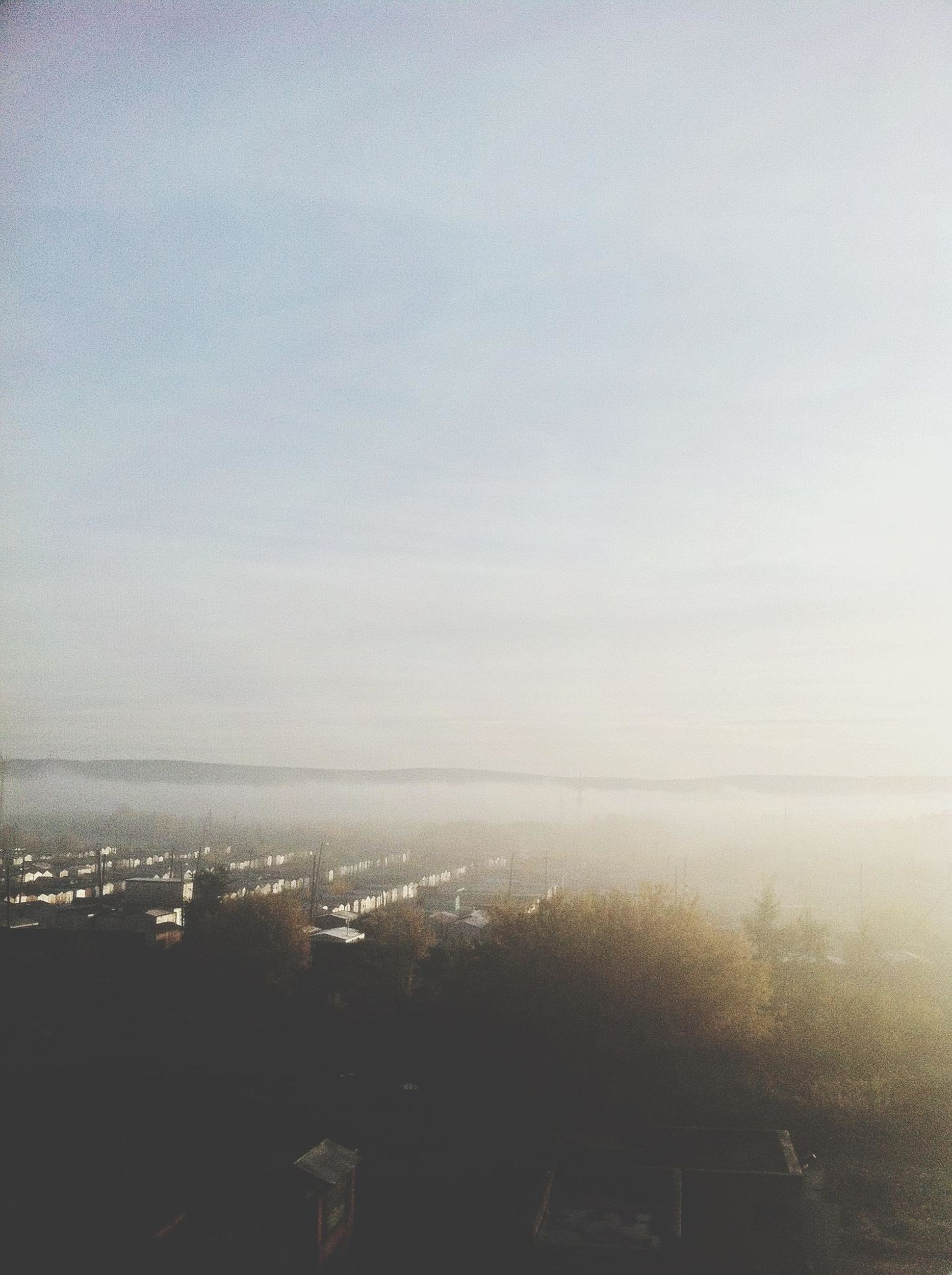 sky, water, copy space, cityscape, fog, foggy, nature, aerial view, weather, scenics, sea, landscape, horizon over water, beauty in nature, city, tranquility, no people, tranquil scene, window
