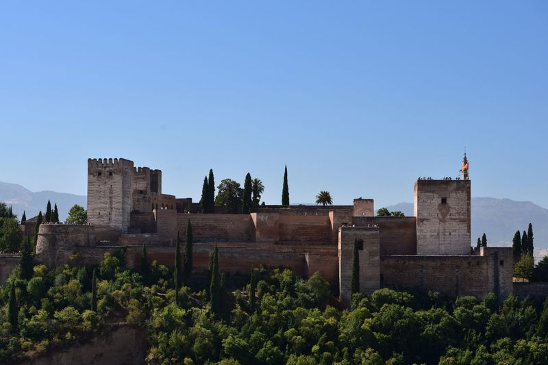 Castle in spain against clear blue sky