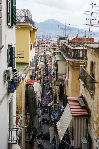 Alley in Naples with Vesuvio in background Alley Alleyway Architecture Building Exterior Built Structure City Day Landscape Mountain Naples Napoli Outdoors Residential Building Sky Vesuvio Volcán Place Of Heart