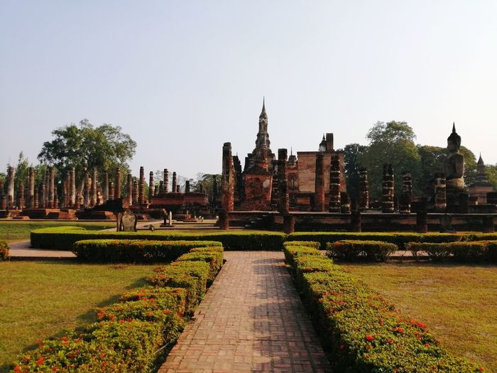 Sukhothai old city Ancient Civilization City Place Of Worship Spirituality Religion History Business Finance And Industry Statue Cultures Architecture Architectural Feature Architectural Detail Architecture And Art Tower Skyscraper Skylight Buddhist Temple Pagoda Architectural Design Cityscape Tall - High Settlement Formal Garden