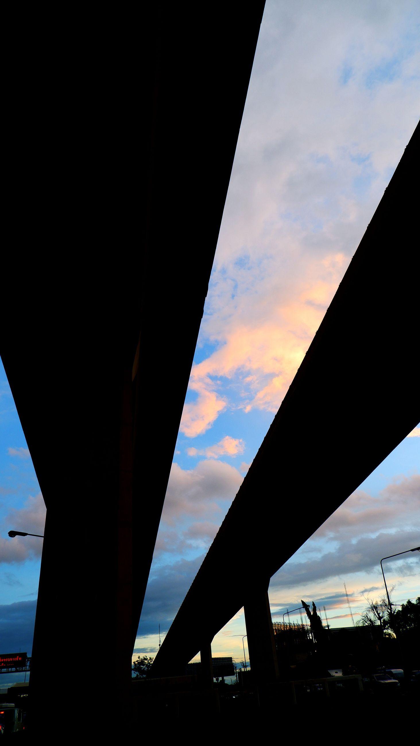 sky, architecture, transportation, silhouette, sunset, built structure, bridge, reflection, evening, dusk, cloud, horizon, nature, sunlight, no people, light, city, outdoors, mode of transportation, road