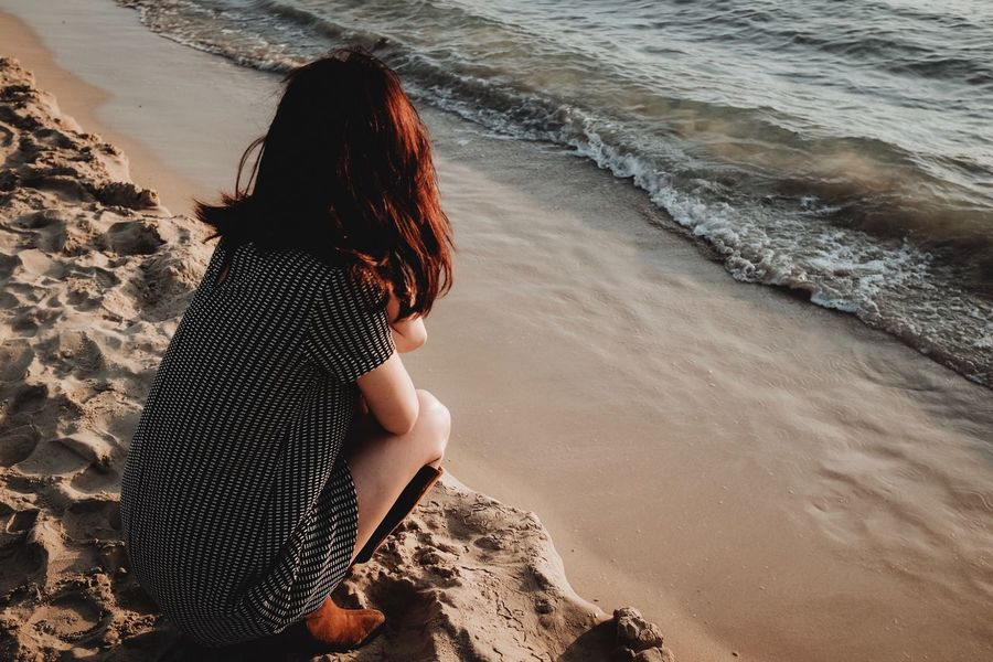 EyeEm Selects Beach Sea Real People Sand Outdoors Women Beauty In Nature Seaside Water Light And Shadow FujiX100T The Week On EyeEm Natural Light Sunset Golden Hour One Person Rear View Beauty In Nature Nature