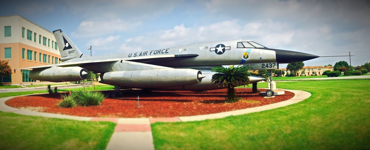 Exploring Airforce Base Kelly field and looking at Antique Aircrafts such as this B-58 Hustler all Silvery Sleek in a Green Grass Field