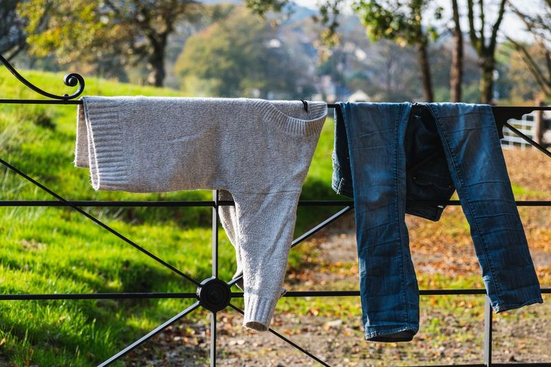 Clothes drying on clothesline on field