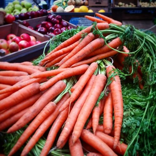 carrots at the market Vegetable Carrot Orange Green Raw Veg The Still Life Photographer - 2018 EyeEm Awards Market Choice Retail  Variation For Sale Close-up Food And Drink Root Vegetable Farmer Market Bunch Root Market Stall Farmer's Market Stall Raw Food Bundle Street Market