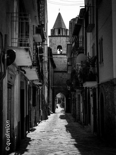 #urbanana: The Urban Playground Ancient City Cobblestone Streets Footpath Street View View Arch Black And White Building City Cobblestone Footpath Long Old Buildings Old City Outdoors Perpective Residential District Stone Street Street Light The Way Forward Town Urban