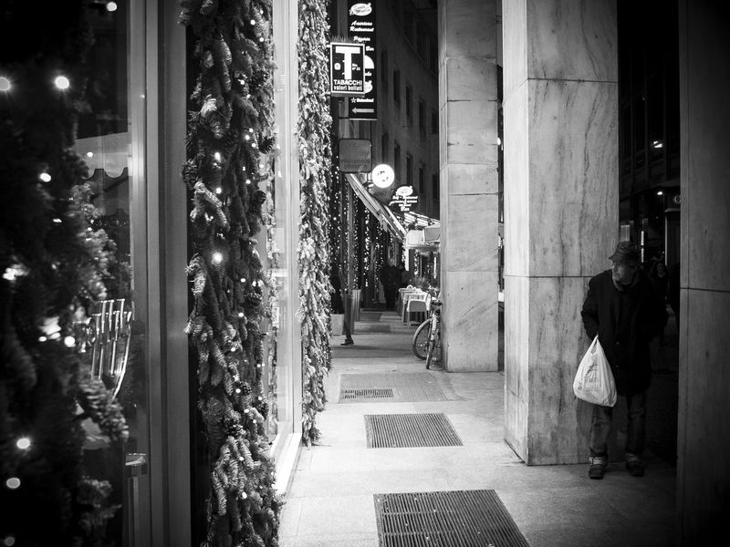 Architecture Bitter Lights Black And White Friday Lifestyles One Person Poverty And Party Lights Real People Unjust Christmas The Street Photographer - 2018 EyeEm Awards
