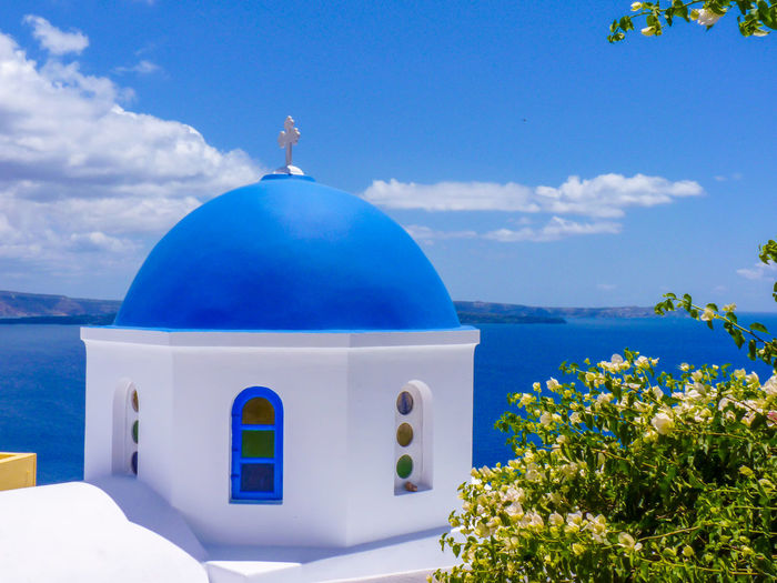 Beautiful church in Santorini island, Cyclades, Greece Architecture Beauty In Nature Blue Building Exterior Built Structure Catholic Church Color Cyclades Day Dome Fira Greece Growth Island Meditterranean Nature Oia Outdoors Santorini Scenics Sky Tourism Turquoise Vibrant Color