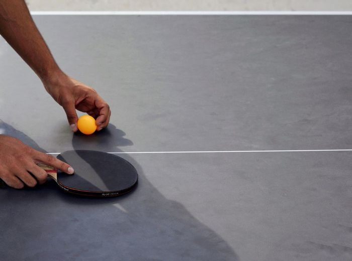 Cropped hands playing table tennis