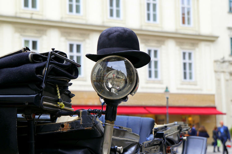 The black hat on a spotlight of a carriage. Vienna, Austria. Vienna Austria Travel Journey Tourism Streetphotography Street Wanderlust Europe Hat Carriage Spotlight Relaxing Lifestyles Transport Harness Coach Cab Style Elégance Walking Medieval Traditional HEAD City