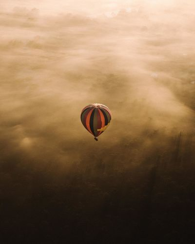 View Of Hot Air Balloon Flying Over Landscape