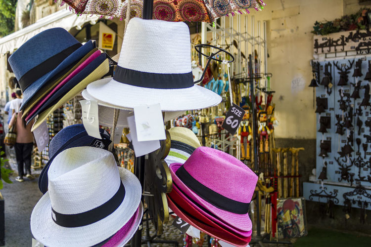 Close-up of hats for sale at market stall