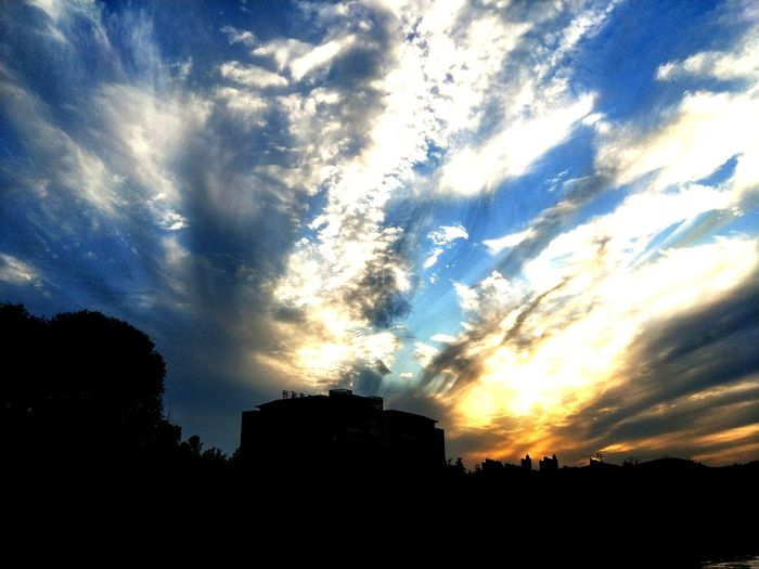 EyeEmNewHere Silhouette Sunset Sky Cloud - Sky Architecture Built Structure Low Angle View No People Beauty In Nature