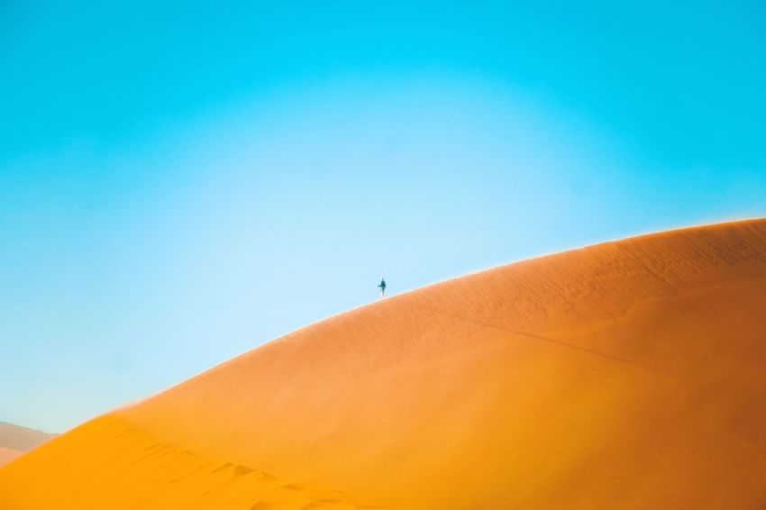 A lone traveller walking on the sand dunes of the Namib Desert in Namibia. 🇳🇦 Namibia Photography Namibia Desert Namibia Landscape Blue Sky Sand Dune Scenics - Nature Copy Space Sand Clear Sky Desert Landscape Outdoors First Eyeem Photo