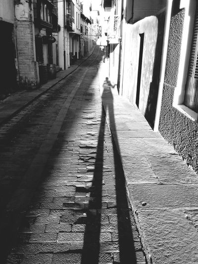 I am a giant. Shadow Sunlight Outdoors Day EyeEmNewHere Streets Full Of History Lost In Time Narrow Streets Lonestreets Stairs To Heaven Made Of Stone The Street Photographer - 2017 EyeEm Awards BYOPaper! The Great Outdoors - 2017 EyeEm Awards The Photojournalist - 2017 EyeEm Awards The Portraitist - 2017 EyeEm Awards BYOPaper! Visual Creativity